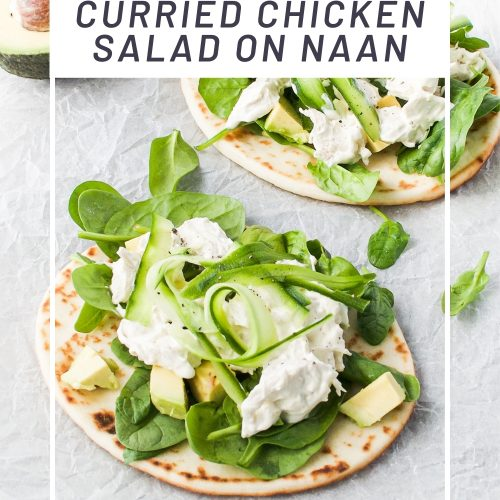 pin for easy leftover chicken recipe, curried chicken salad on naan, showing an angled photo of two naan breads topped with chicken salad.